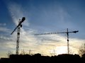 Two tower cranes and blue sky Royalty Free Stock Images