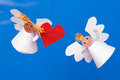 Two toy angel and heart Stock Photography