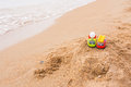 Two toy cars left children on the beach Royalty Free Stock Photo