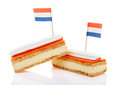 Two traditional dutch pastry called tompouce flags over white background Stock Images