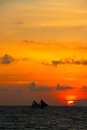 Two traditional sail boats catch the last glimps of the sunset on boracay island in philippines Stock Photo