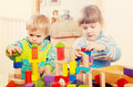 Two  tranquil children playing with wooden toys Royalty Free Stock Photo