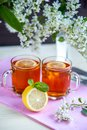 Two transparent cups with tea. Green, black, herbal, jasmine tea Royalty Free Stock Photo