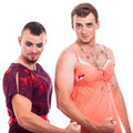 Two transvestites showing muscles isolated on white background Royalty Free Stock Photo