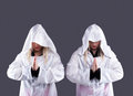 Two transvestites in white cloaks Stock Photos