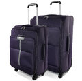 Two travel suitcases on a white background dark purple bags Stock Photo
