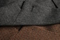 Two tweed coat lapels side by side a gray and a brown classic woolen tweet coats detail Stock Photography