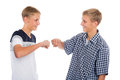 Two twin brothers greet each other with fists hands Stock Images