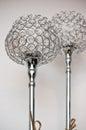 Two unique silver chrome lamps