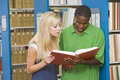 Two university students working in library Royalty Free Stock Photo