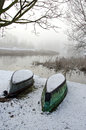 Two upturned boats on winter snow Royalty Free Stock Photo