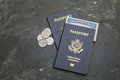 Two us passports on black background american citizenship social security card in a document traveling around the world coins a Stock Images