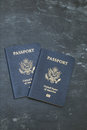 Two us passports on black background american citizenship traveling around the world Stock Photography