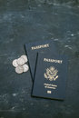 Two us passports on black background american citizenship traveling around the world coins a side Stock Photography