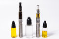 Two vape e cig and three vape juice bottles accesories all logo text removed Royalty Free Stock Photos