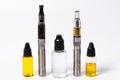 Two Vape E-Cig and Three vape juice bottles Royalty Free Stock Photo