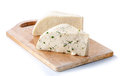 Two varieties of soft cheese slabs on wooden board isolated cutting over white background Stock Images