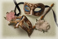 Two venetian masks with artificial flowers Stock Photography