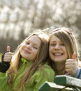 Two very happy grils in a park Stock Image