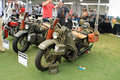 Two vintage american military motorcycle restored classic historic motorcycles next to each other in foreground harley davidson xa Stock Photo