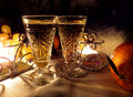 Two vintage champagne wineglass festive evening candle and gentle sweet green grapes. Royalty Free Stock Photo