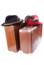 Two vintage suitcases tradition bavarian hats over white Stock Photo