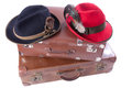 Two vintage suitcases tradition bavarian hats over white Stock Photography