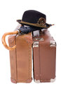 Two vintage suitcases umbrella hat over white Stock Photo