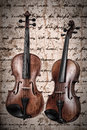 Two violins on an antique texture background Stock Photography