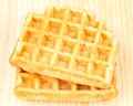 Two waffles wooden table typical dessert belgium Stock Photography