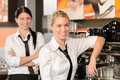 Two waitresses posing in coffee house Royalty Free Stock Photo
