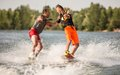 Two wake bord riders having fun are Royalty Free Stock Photo