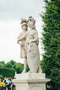 Two warior statues ancient male wariors statue in schonbrunn palace in vienna austria surrounded by vivid green trees through Royalty Free Stock Photo