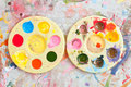 Two watercolor palette on the painted white canvas Royalty Free Stock Images