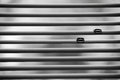 Two wedding rings on blinds black and white photo Royalty Free Stock Photos