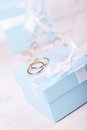 Two wedding rings on blue box Stock Photography