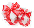 Two white boxes tied red ribbon bow  on the white Royalty Free Stock Photo