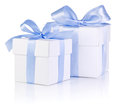 Two White boxs tied with a Blue satin ribbon bow Royalty Free Stock Image