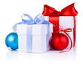 Two white boxs tied with satin ribbon bow a red and blue christmas balls isolated on background Royalty Free Stock Images
