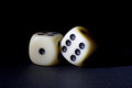 Two White Dices Isolated on Black Royalty Free Stock Photo