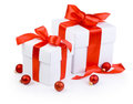 Two white gift boxs tied red ribbon and Christmas balls Isolated Royalty Free Stock Photo