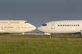 Two white planes are kissing Royalty Free Stock Photography