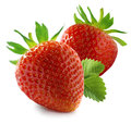 Two whole red strawberries on white background and leaves as package design elements Stock Photos