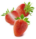 Two whole strawberries and one half  on white background Royalty Free Stock Photo