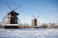 Two windmills and church Royalty Free Stock Image