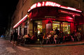 Two windmills restaurant in paris tourists eat at café des deux moulins rue lepic it takes its name from the nearby Royalty Free Stock Image
