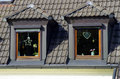 Two windows on mansard roof with christmas decorations germany Royalty Free Stock Photography