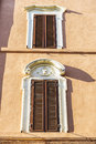 Two windows of an old classic building in Rome, Italy Royalty Free Stock Photo