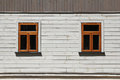 Two windows on white wooden wall Stock Image