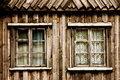 Two windows in a wooden cottage Stock Photo